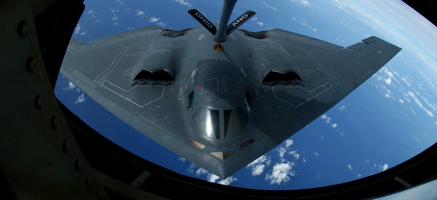 A KC-135 Stratotanker refuels a B-2 Spirit over the Pacific Ocean.