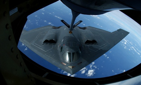 A KC-135 Stratotanker refuels a B-2 Spirit over the Pacific Ocean.