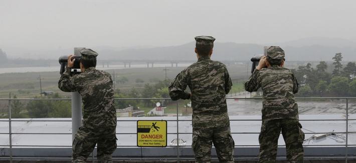 South Korean marine force members look toward North's side through binoculars at the Imjingak Pavilion in Paju near the border village of Panmunjom, South Korea, May 16, 2018.