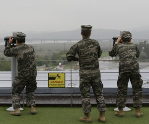 South Korean marine force members look toward North's side through binoculars at the Imjingak Pavilion in Paju near the border village of Panmunjom, South Korea, May 16, 2018.