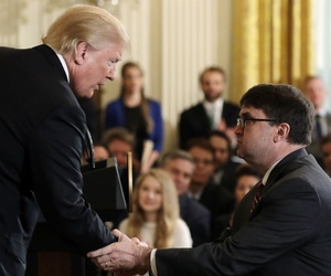 President Trump shakes hands with Acting Veterans Affairs Secretary Robert Wilkie, during an event on prison reform in the East Room of the White House, Friday, May 18.