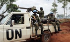 In this photo taken Friday May 26, 2017, UN peacekeepers patrol outside Bria, Central African Republic.