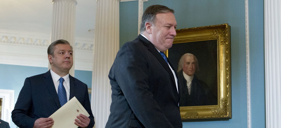 US Secretary of State Mike Pompeo accompanied by Georgian Prime Minister Giorgi Kvirikashvili arrive for a news conference before their bilateral meeting at the State Department, Monday, May 21, 2018, in Washington.