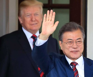 South Korean President Moon Jae-in waves as he is welcomed by President Donald Trump to the White House on Tuesday.