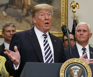 President Donald Trump speaks in the Roosevelt Room of the White House, May 24, 2018, in Washington, as Vice President Mike Pence looks on, right.