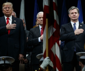President Trump, Attorney General Jeff Sessions, and FBI Director Christopher Wray stand for the national anthem during the FBI National Academy graduation ceremony Dec. 15, 2017, in Quantico, Va.
