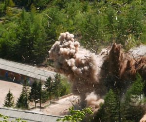 Smoke and debris rise in the air as barracks buildings for guards and tunneling workers at North Korea's nuclear test site are blown up at Punggye-ri, North Hamgyong Province, North Korea, on May 24, 2018.