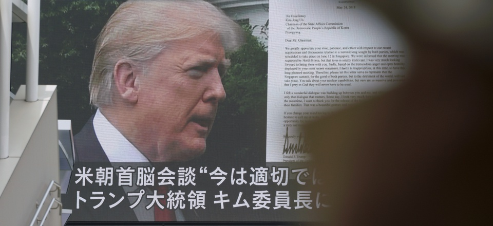 A TV screen showing U.S. President Donald Trump, right, in Tokyo, May 25, 2018.