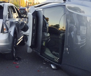 This March 24, 2017, photo provided by the Tempe Police Department shows an Uber self-driving SUV that flipped on its side in a collision in Tempe, Ariz.