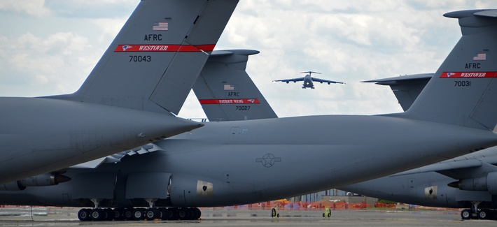 C-5 Galaxy tails on the flightline frame a C-5 on final approach to Westover Air Reserve Base.