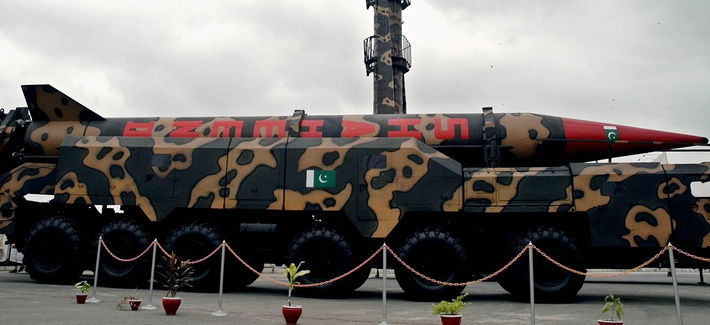 A Pakistan-made Shaheen missile capable of carrying nuclear heads, front, is displayed at a defense exhibition on, September 14, 2004 in Karachi, Pakistan.