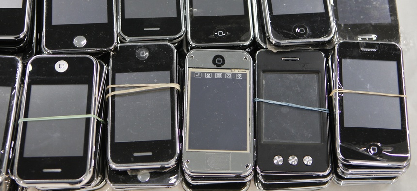 Los Angeles Port Police display seized counterfeit Apple iPhones during a news conference at the Port of Los Angeles Monday, Feb. 7, 2011. Authorities in the the Port of Los Angeles complex seized phony iPods, iPhones and other electronics.