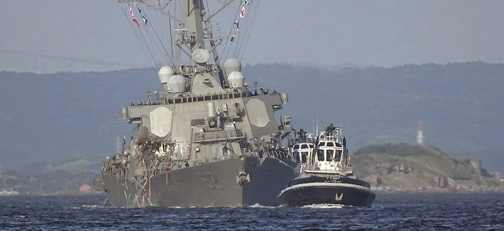 June 17, 2017: the damaged USS Fitzgerald is towed by a tugboat in the waters near the U.S. Naval base in Yokosuka, southwest of Tokyo, after the U.S. destroyer collided with the Philippine-registered container ship ACX Crystal.