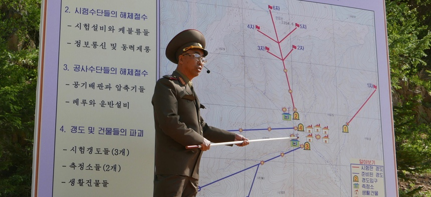 The Deputy Director of North Korea's Nuclear Weapons Institute, who would not give his name, briefs reporters about the dismantling of North Korea's nuclear test site, in Punggye-ri, North Hamgyong Province, North Korea, Thursday, May 24, 2018.