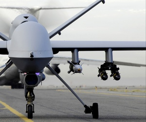 MQ-9 Reaper taxies down a runway in Afghanistan.