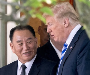 President Donald Trump talks with Kim Yong Chol, former North Korean military intelligence chief and one of leader Kim Jong Un's closest aides, as they walk from their meeting in the Oval Office of the White House in Washington, Friday, June 1, 2018.