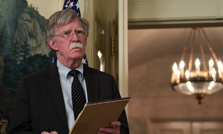 National security adviser John Bolton listens as President Donald Trump speaks in the Diplomatic Reception Room of the White House on Friday, April 13, 2018