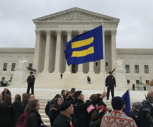 Human Rights Campaign Flag being waved at the Supreme Court of the United States on December 5, 2017 in support of gay rights during the Cake Shop Religious Liberties/Gay Rights case.