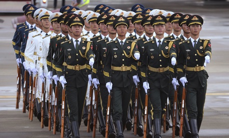 Chinese People's Liberation Army honor guard march after Russian President Vladimir Putin arrived at Xiamen Gaoqi International Airport to attend the upcoming BRICS Summit in Xiamen, China's Fujian province, Sunday, Sept. 3, 2017.