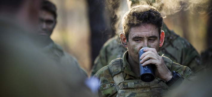 An Australian Army soldier of 2nd Battalion, the Royal Australian Regiment, drinks a hot coffee during orders at Shoalwater Bay Training Area in North Queensland during Exercise Talisman Saber 17 in 2017.