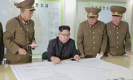 In this file image made from video of an Aug. 14, 2017, broadcast in a news bulletin by North Korea's KRT, North Korean leader Kim Jong Un receives a military briefing in Pyongyang.