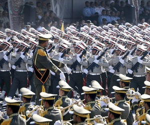 Iranian armed forces members march in a military parade marking the 37th anniversary of Iraq's 1980 invasion of Iran, in front of the shrine of the late revolutionary founder, Ayatollah Khomeini, just outside Tehran, Iran, Friday, Sept. 22, 2017.