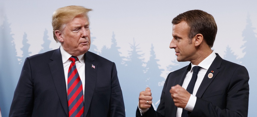 President Donald Trump meets with French President Emmanuel Macron during the G-7 summit Friday, June 8, 2018, in Charlevoix, Canada.