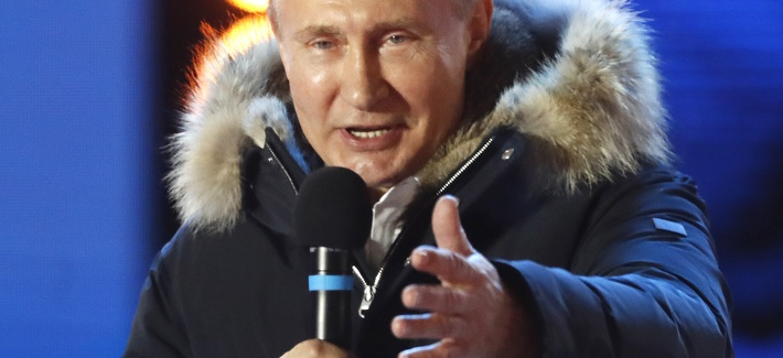 Russian President Vladimir Putin gestures as he speaks to supporters during a rally near the Kremlin in Moscow, Sunday, March 18, 2018.