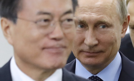 Russian President Vladimir Putin, right, and his South Korean counterpart Moon Jae-in arrive for their meeting at the Eastern Economic Forum in Vladivostok, Russia, on Wednesday, Sept. 6, 2017.