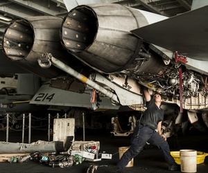 U.S. Navy Aviation Machinist's Mate 2nd Class Alexandra Mimbela performs maintenance on an F/A-18F Super Hornet aircraft assigned to Strike Fighter Squadron (VFA) 213 aboard the aircraft carrier USS George H.W. Bush (CVN 77) Aug. 21, 2014.
