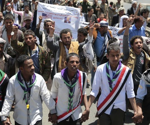 People take part in a march, denouncing plans by the Arab coalition to attack Hodeidah, from Sanaa to the port city of Hodeidah, Yemen, Wednesday, Apr. 19, 2017.