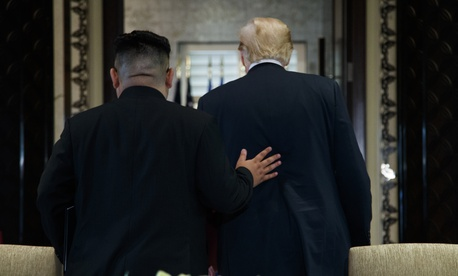 President Donald Trump and North Korean leader Kim Jong Un walk off after a signing ceremony during a meeting on Sentosa Island, Tuesday, June 12, 2018, in Singapore.