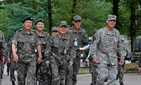 South Korean Adm. Choi Yoonhee, center, ROK's top officer; U.S. Lt. Gen. Stephen Lanza, right, who leads I Corps; and South Korean Gen. Hyunjip Kim, left, 3rd ROK commander, at Camp Yongin, South Korea, during Ulchi Freedom Guardian 2014.