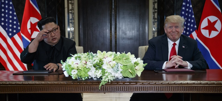 President Donald Trump and North Korean leader Kim Jong Un participate in a signing ceremony during a meeting on Sentosa Island, Tuesday, June 12, 2018, in Singapore.