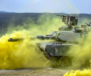 Soldiers in an M1 Abrams tank compete in the Strong Europe Tank Challenge at the Grafenwoehr Training Area in Germany, June 6, 2018.