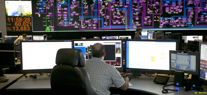 Electrical power flow and conditions are monitored at the Pacific Gas & Electric grid control center, Thursday, Aug. 17, 2017, in Vacaville, Calif.