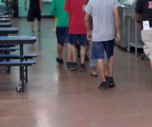 Children walk in the Casa Padre cafeteria.