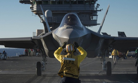 An F-35C Lightning II carrier variant joint strike fighter is prepared for launch aboard the aircraft carrier USS Nimitz (CVN 68).