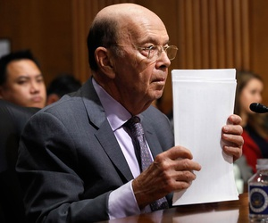 Secretary of Commerce Wilbur Ross straightens his papers during a Senate Finance Committee hearing on tariffs on Wednesday.