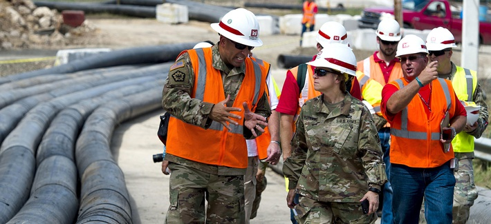 Army Brig. Gen. Diana Holland, commander of the Army Corps of Engineers' South Atlantic Division, surveys Guajataca Dam in Puerto Rico, Oct. 23, 2017.