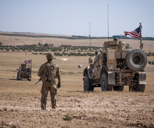 A U.S. Soldier stands guard during a security patrol outside Manbij, Syria, June 24, 2018.
