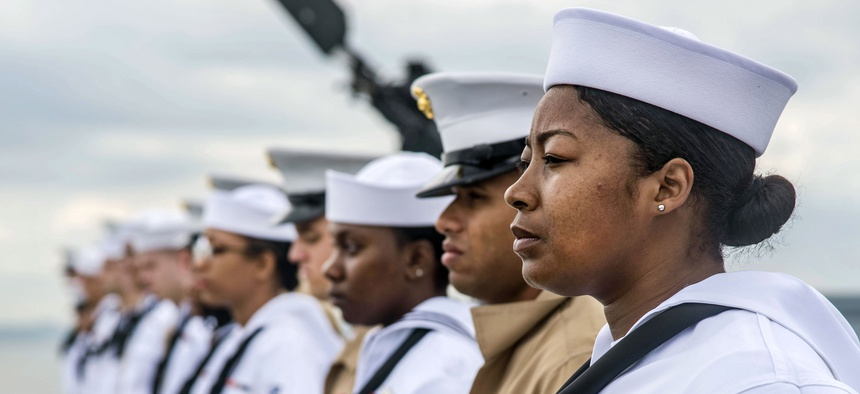 Sailors and Marines man the rails aboard the USS Arlington (LPD-24) in New York City for Fleet Week, May 22, 2018.