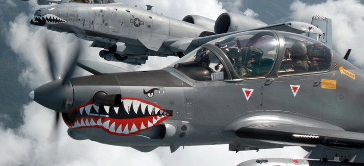 A Colombian Air Force A-29B Super Tucano flies alongside two U.S. Air Force A-10s during Exercise Green Flag East August 2016.