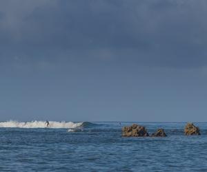Honolulu, Hawaii, USA. June 14, 2018. A surfer enjoys a wave at Ala Moana Bowls.