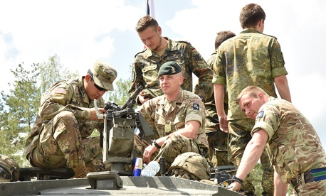 German, U.K., and U.S. tank platoons tour and inspect each other's tanks before the opening ceremony of the Strong Europe Tank Challenge, held at 7th Army Training Command's Grafenwoehr Training Area, June 3, 2018.