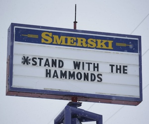 In this Jan. 5, 2016, photo, a sign in Burns, Ore., shows local support for Dwight and Steven Hammond after they were sentenced to 5 years in prison for setting fires on federal land.
