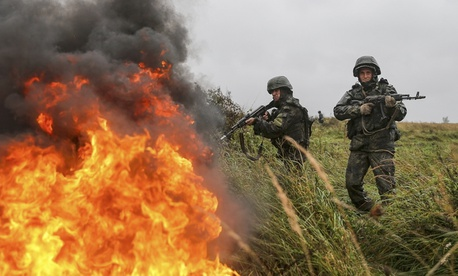 This photo provided Tuesday, Sept. 19, by Russian Defense Ministry official web site shows Russian troops during a military exercise at a training ground near Kaliningrad, Russia, Monday, Sept. 18, 2017.