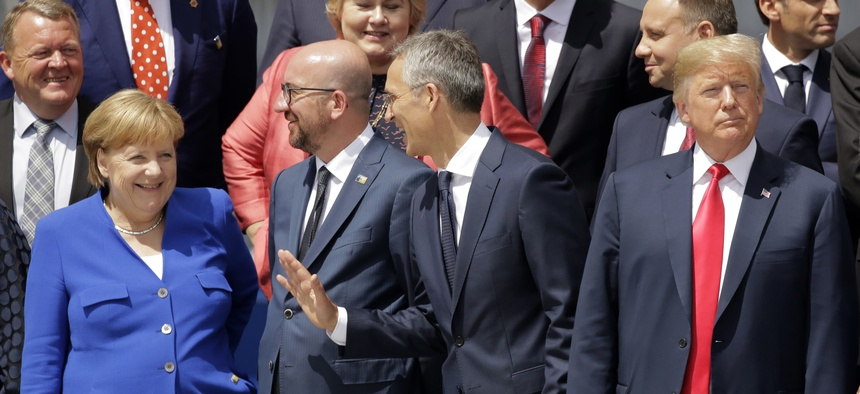 German Chancellor Angela Merkel, Belgian Prime Minister Charles Michel, NATO Secretary-General Jens Stoltenberg and U.S. President Donald Trump, from left, watch a fly-by during a summit at NATO headquarters in Brussels Wednesday, July 11, 2018.