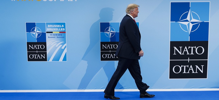 President Donald Trump enters the NATO Summit of heads-of-state and -government at headquarters in Brussels on Wed., July 11, 2018.