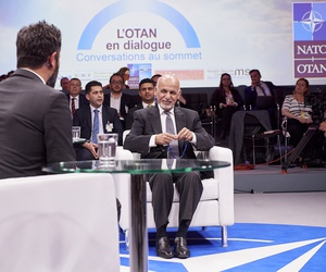 "Afghan President Ashraf Ghani speaks at the NATO Summit sideline event ""NATO Engages"" with Defense One Executive Editor Kevin Baron, in Brussels, Thur., July 12, 2018."
